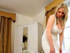 lovely golden-haired bride teasing on ottoman
