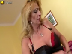mature redhead sticks sex toy about her curly slit