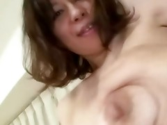 asian older shows her shaggy cunt