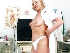blonde granny nurse using gyno cunt spreader