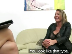 older woman banging on leather couch