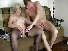 chubby golden-haired granny seduces a y...