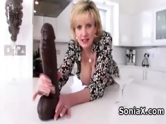 naughty older playing with giant sex-toy
