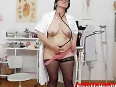 dark brown practical nurse examining her wet crack