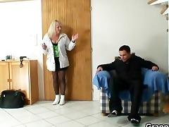 blond grandma in dark stockings copulates