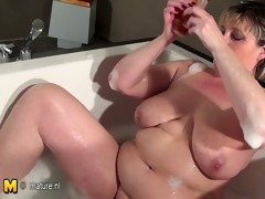 aged doxy mother with saggy scoops taking a baths