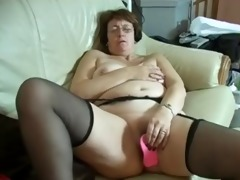 granny in glasses and nylons with toys