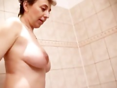 aged pair in the shower