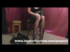 immodest redhead put on leather petticoat and