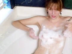 smiling mother i bathtub bubbles