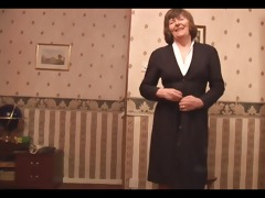 attractive granny in nylons and girdle shows off