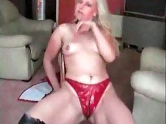 breasty blond dances on chair