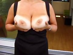 golden-haired huge-boobs-milf posing