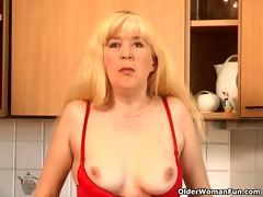 blonde granny copulates herself on the kitchen