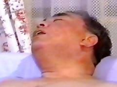 oriental aged chap masturbates on bed