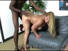 lascivious blond cougar enjoys herself with