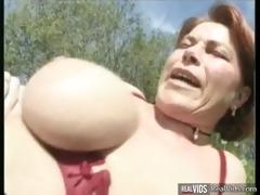 chunky mamma riding cock in the sun