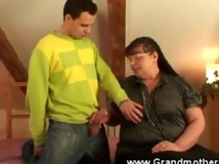 breasty granny taking care of cock