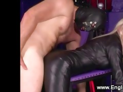 mistress rules over subject inside the playroom