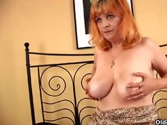 redheaded granny with big boobs sucks dong and