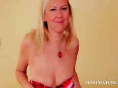 sex bomb blonde aged sensually stripping her